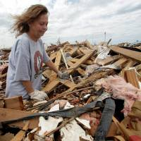 Waste-deep: Carol Kawaykla pauses while searching for items in her tornado-ravaged home  Thursday in Moore, Oklahoma. | AP