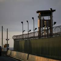 Blot on the copybook: U.S. personnel guard the detention facility at the naval base in Guantanamo Bay, Cuba. | AP