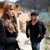 Humanitarian mission: Angelina Jolie (left) and Brad Pitt visit refugees in Bosnia on April 5, 2010, to highlight the plight of 117,000 people who have not been able to return to their homes even though the Bosnian war ended 15 years earlier. | AP