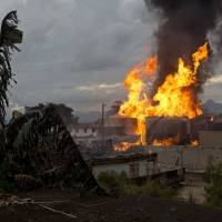 Giant fuel depot blaze on northern outskirts of Rio de Janeiro kills one