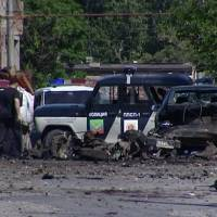 Explosive force: Debris litters the ground near a wrecked police car in Makhachkala, Dagestan, on Saturday after a twice-widowed suicide bomber blew herself up. | AP