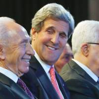 Economic accord?: U.S. Secretary of State John Kerry, Israeli President Shimon Peres (left) and Palestinian President Mahmoud Abbas participate in a World Economic Forum meeting at the King Hussein Convention Center on the banks of the Dead Sea in Jordan on Sunday. | AP