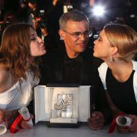Big winner: Director Abdellatif Kechiche (center) and actresses Adele Exarchopoulos (left) and Lea Seydoux pose Sunday with the Palme d'Or award for the film 'Blue is the Warmest Color: The Life of Adele' at the 66th Cannes Film Festival in southern France. | AP
