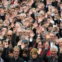 Public ballot: People raise their hands to vote during the annual Landsgemeinde meeting in the town of Appenzell, Switzerland, in April. | AFP-JIJI