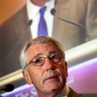 Stern address: U.S. Defense Secretary Chuck Hagel speaks at the International Institute for Strategic Studies Shangri-la Dialogue Asia security summit in Singapore on Saturday. | AP