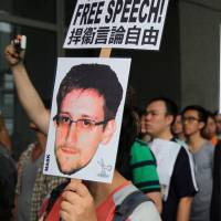 Hong Kong help: Supporters of Edward Snowden gather outside the Hong Kong government building Saturday. | BLOOMBERG