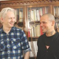 Sing a song of censorship: Rene Perez Joglar, better known as Residente from the Latin music group Calle 13, and WikiLeaks founder Julian Assange get together to collaborate on a song about censorship Wednesday at the Ecuadorian Embassy in London. | AP
