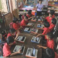 Tablet computers thrust Thailand classrooms into digital era