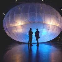Trial balloon: Visitors check out a Google Wi-Fi Internet balloon displayed at Christchurch's Air Force Museum on Sunday. | AFP-JIJI