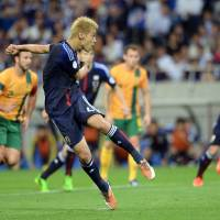 Rice power: Keisuke Honda scores the qualifying goal for Japan in its qualifying match for the 2014 World Cup against Australia on June 4. | AFP-JIJI