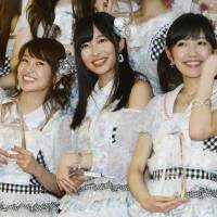 Idol vote: The winner of this year's AKB48 election, Rino Sashihara (center) with last year's winner Yuko Oshima (left) and 2013 No. 3 Mayu Watanabe (right). | KYODO