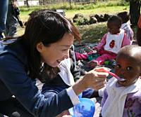 Agnes Chan with an orphan at the Touching Tiny Lives facility at Mokhotlong. | ARTHUR KANEKO PHOTO