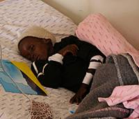 An HIV-positive child receives treatment at Mokhotlong Hospital. | ARTHUR KANEKO PHOTO
