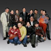 Putting on a smile: A family squeeze together for a portrait snapshot in Liu Qing's sculpture 'Say Cheese' (2008). | COURTESY OF THE NARA PREFECTURAL MUSEUM OF ART