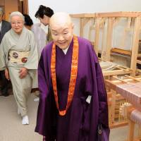 Defying boundaries: The former Harumi Setouchi, who wrote 'Beauty in Disarray' and is known by the Buddhist name Jakucho after taking vows in 1973, visits a school in Kyoto in April. | KYODO