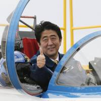 Iceman: Japanese Prime Minister Shinzo Abe inside a T-4 training jet plane of the Air Self-Defense Force's Blue Impulse flight team. Abe has vowed to amend the war-renouncing Article 9 of the nation's Constitution. | KYODO
