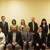 Cultured group: Kyoto Journal founder John Einarsen (far right, front) and photojournalist Everett Kennedy Brown (third from right, back) were among those given awards for promoting Japanese culture abroad by Cultural Affairs Agency Commissioner Seiichi Kondo (center, front). | NATASHA VIK