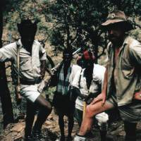 Active duty: Young Nic (right) on patrol while serving as a Game Warden in the Simien Mountains of northern Ethiopia in the late 1960s. The man on the left, with a rifle slung over his shoulder, was Assistant Warden Mesfin Abebe, and the two men behind were local vigilantes who joined us in pursuit of illegal loggers. | C.W. NICOL PHOTOS
