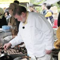 Waste not — want a lot: Chef Nicol makes griddles of venison sausages sizzle at the C.W. Nicol Afan Woodland Trust's Forest Kitchen booth set up as part of the annual Earth Day Tokyo weekend in April. Whenever venison is on the menu at public events like this, all the dishes invariably sell out well before the end.   CONAN MORIMOTO