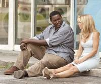 Nice pair: Quinton Aaron and Sandra Bullock in 'The Blind Side' | © 2009 ALCON FILM FUND, LLC. ALL RIGHTS RESERVED