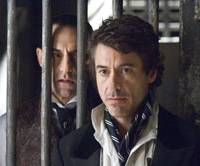 Sexy sleuth: Robert Downey Jr. (right) takes on the role of famed detective Sherlock Holmes, with Mark Strong (left) playing the role of the villainous Lord Blackwood. | © 2009 VILLAGE ROADSHOW FILMS (BM) LIMITED