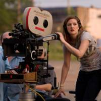 Behind the cameras: Actress Drew Barrymore switches sides to direct her first feature film, 'Whip It.'