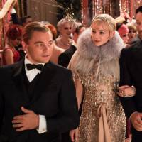 Great party: Leonardo DiCaprio (left) speaks with co-stars Carey Mulligan (center) and Joel Edgerton in a scene from director Baz Luhrmann's 'The Great Gatsby.' DiCaprio says he doesn't share too much in common with his character, Jay Gatsby, who is presented as an extremely flashy type. | © 2013 WARNER BROS. ENTERTAINMENT INC. ALL RIGHTS RESERVED