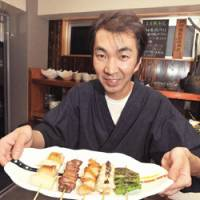 Finest fowl: Chef Kenji Yoshimoto (above) uses only premium chicken at his yakitoriya, Yoshicho. Other popular dishes include ontama soboro-don, a rice bowl with chicken and egg, and skewers of shiitake and gingko nuts. | YOSHIAKI MIURA PHOTO / ROBBIE SWINNERTON