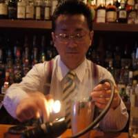 Smoking gun: Hidetsugu Ueno of High Five in Ginza adds a blast of aloeswood to his cocktail.