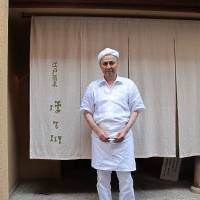 In good hands: Soba master Takashi Hosokawa stands in front of his eponymous noodle restaurant, where the menu includes yaki-miso made with buckwheat grains and scallion.