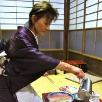 Dressing the part: Botan's kimono-clad waitresses hint at the restaurant's history . it has served sukiyaki for over a century.