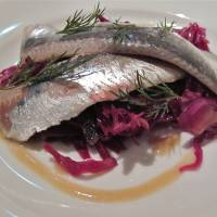 Vinegar-marinaded sardine fillets on red cabbage | ROBBIE SWINNERTON