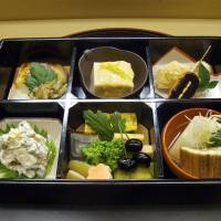 Kaiseki multicourse dishes are served in surroundings less austere than at Kikunoi's two Kyoto branches. | ROBBIE SWINNERTON