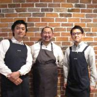 New build: Chef Takahisa Nagasawa (center), a veteran of Blue Note's restaurant adding:blue, leads the kitchen at new venture Cafe 104.5. | ROBBIE SWINNERTON