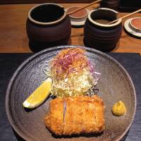 Pigging out: The meat in Katsuzen's pork cutlets comes from free-range hogs raised on the slopes of Mount Kirishima in Kyushu. | ROBBIE SWINNERTON