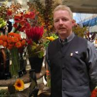 Bouquets abound: Hans Damen, chief designer at U.Goto Florist, poses with abundant flowers at the company's main store in Roppongi, Tokyo. | TOMOKO OTAKE PHOTO