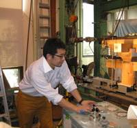 Heavy-handed: Researcher Akihisa Kitamori brings increasing pressure to bear as he tests the strength of a two-thirds replica of a ceiling support structure from Yakushi Temple in Nara. | WINIFRED BIRD PHOTO