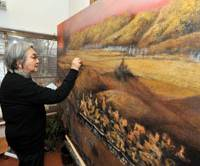Grand design: Taeko Tomiyama adds a few sheep to her work-in-progress, a landscape of Afghanistan, that will be part of a series about the Eurasian continent. | YOSHIAKI MIURA PHOTO