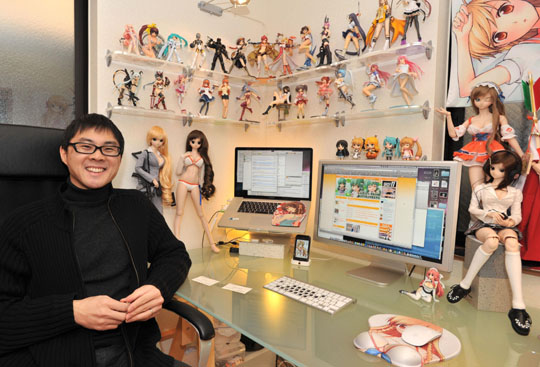 his life and love of figurines at his home office in Tokyo on Jan. 7