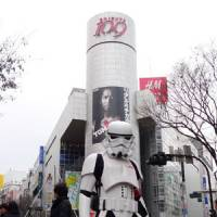 Danny Choo in a 'storm trooper' costume poses for a photo on a street in Tokyo's Shibuya. | COURTESY OF DANNY CHOO