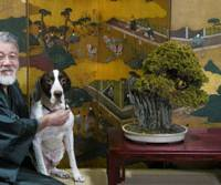 Proud owner Yasuo Toda at home with his English pointer, Woowo.   YASUO TODA PHOTO