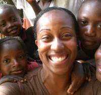 Francesca Conate is surrounded by children in the Sierra Leone capital of Freetown during her trip there in December 2006. | PHOTO COURTESY OF FRANCESCA CONATE