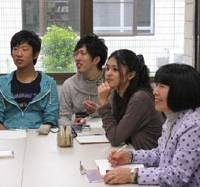 Among equals: Yoshiko Matsuzaki (on the right) sits with fellow students well over 30 years her junior as she attends a music-production class at Wakayama University. 'I applied through a special process for older students, and I got in. I'm so glad I did,' she said.