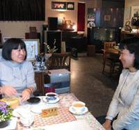 Matsuzaki (left) and Michiru Hanai chat together over a cuppa in Matsuzaki's audio equipment/antiques store. Both women are in the final year of their undergraduate degree courses at Wakayama University.