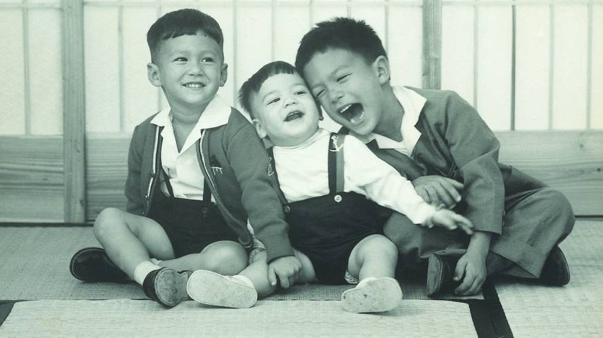 Take three : Jon Kabira, right, at home in Okinawa with his brothers.