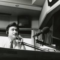 Personal touch: J-Wave 'navigator' Jon Kabira live on air in October 1989.