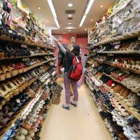 Footwear, footwear everywhere:  These days, not only  Westerners but also many Japanese have problems tracking down shoes that are big enough. | BLOOMBERG