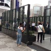 Lighting up a storm:  The new smoking area in front of the East Exit of Ikebukuro Station in  Tokyo's  Toshima Ward is now open for business. | AKINORI KURUMA