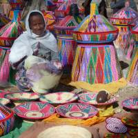 Worlds of color: A basket-seller in Aksum. | LESLEY DOWNER PHOTO