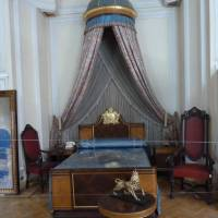 The canopied bed of Emperor Haile Selassie in his former palace in Addis Ababa, now the Ethnological Museum. | LESLEY DOWNER PHOTO